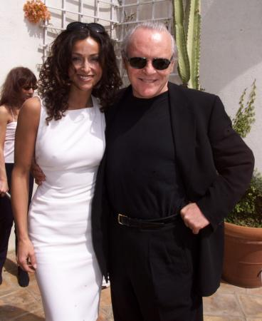 BEVERLY HILLS, CALIFORNIA - Italian actress Sofia Milos poses with actor Anthony Hopkins prior to a luncheon honoring Italian Academy Award nominees at Dino DeLaurentiis' mansion in Beverly Hills March 24. Hopkins is starring in the upcoming film 'Hannibal' produced by DeLaurentiis. Milos was a guest at the luncheon. The Academy Awards will be presented March 26 in Los Angeles. fsp/Photo by Rose Prouser (Reuters)