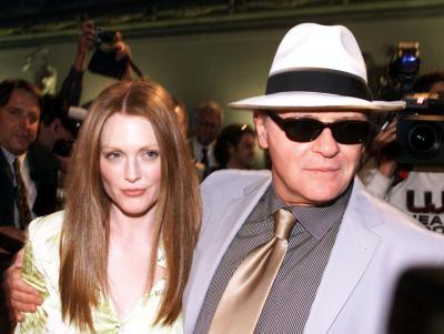 American actress Julianne Moore, left, and Anthony Hopkins arrive in Florence's historical Palazzo Vecchio prior to the start of the press conference announcing the start of the shooting of the movie 'Hannibal,' Thursday, May 4, 2000. A sequel to the Oscar-winner 'The Silence of the Lambs,' the movie will be directed by Ridley Scott, stars Hopkins Moore, and will be filmed for five weeks in Florence and its outskirts starting next Monday, May 8, 2000. Photo by Francesco Bellini (AP)