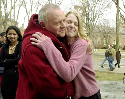 Anthony Hopkins gets a hug from Harvard Radcliffe undergraduate student Anna Engstrom as Hopkins tours Harvard Yard in Cambridge, Massachusetts after arriving to be honored February 15, 2001 as the University's 'Hasty Pudding 2001 Man of the Year.'  Handout/Harvard News Office/Justin Ide (Reuters)