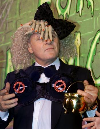 Sir Anthony Hopkins holds the traditional 'Hasty Pudding Pot,' wearing a hat of fake human fingers and a bra festooned with black lambs' heads while being honored February 15, 2001 as Harvard University's 'Hasty Pudding 2001 Man of the Year.'  Photo by Jim Bourg (Reuters)