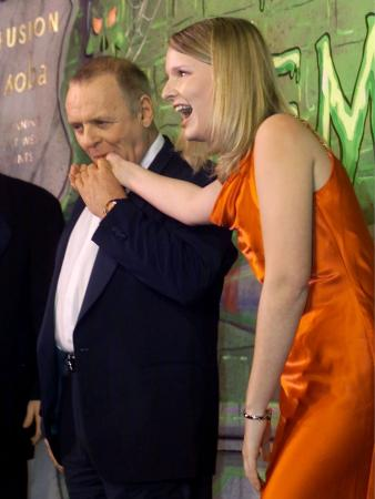 British actor and 'Hannibal' star Sir Anthony Hopkins playfully nibbles on the thumb of Harvard University student Suzanne Pomey after she feigned fear of the renowned film cannibal while honoring Hopkins February 15, 2001 as Harvard University's 'Hasty Pudding 2001 Man of the Year.'  Photo by Jim Bourg (Reuters)