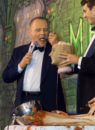 British actor and 'Hannibal' star Sir Anthony Hopkins accepts a challenge from Harvard student Ben Forkner and eats fake brains from a plastic head as Hopkins was honored as Harvard University's 'Hasty Pudding 2001 Man of the Year' February 15, 2001.  Photo by Jim Bourg (Reuters)