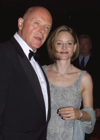 BEVERLY HILLS, CALIFORNIA - Actress Jodie Foster poses with actor Sir Anthony Hopkins as they arrive for the American Cinematheque Moving Picture Ball October 9 in Beverly Hills. Foster was honored at the Ball for her significant contribution to the art of film and video.  Photo by Rose Prouser (Reuters)