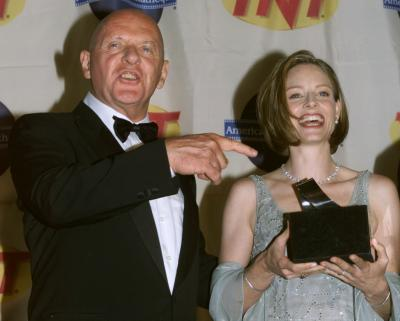 BEVERLY HILLS, CALIFORNIA - Sir Anthony Hopkins presents an award to actress Jodie Foster at the American Cinematheque Moving Picture Ball October 9 in Beverly Hills. Foster was honored at the Ball for her significant contribution to the art of film and video. Hopkins and Foster starred in the film 'Silence of The Lambs.' Photo by Rose Prouser (Reuters)