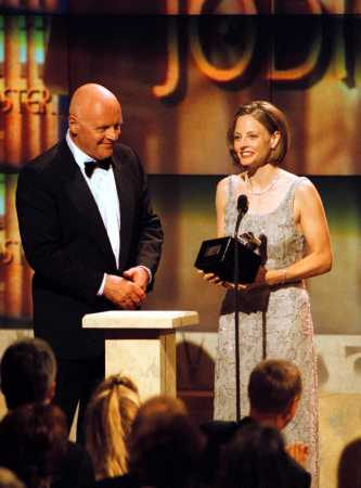 Anthony Hopkins presents Oscar-winning actress Jodie Foster with the American Cinematheque award Saturday night, Oct. 9, 1999, during a taped salute to her in Beverly Hills, Calif. The show will air Sunday, Oct. 17, 1999, on Turner Network Television. (AP Photo/TNT, Craig T. Matthew)
