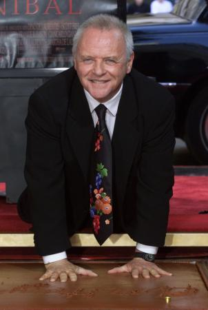 Actor Anthony Hopkins places his handprints in the forecourt of Mann's Chinese Theater Janaury 11, 2001 in Hollywood.  Photo by Fred Prouser (Reuters)