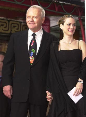 British actor Anthony Hopkins is joined by actress Winona Ryder before he got his hands and feet in the cement at the Mann's Chinese Theater in the Hollywood section of Los Angeles, Thursday, Jan. 11, 2001. Hopkins and Ryder acted together in the 1992 film, 'Bram Stoker's Dracula.' Photo by Chris Pizzello (AP)