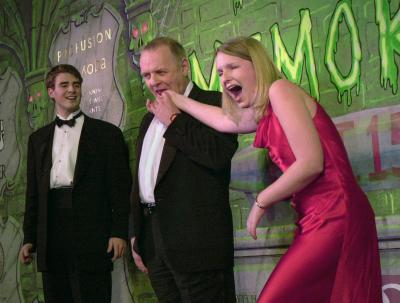 Anthony Hopkins takes a little nibble of Suzanne Pomey's hand as Ben Forkner watches at the Hasty Pudding Theater in Cambridge, Mass., Thursday, Feb. 15, 2001. Hopkins received the man of the year award from members of the Hasty Pudding Theatricals.  Photo by Lawrence Jackson (AP)