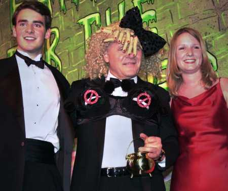 Sir Anthony Hopkins poses with Ben Forkner and Suzanne Pomey at the Hasty Pudding Theater in Cambridge, Mass., Thursday, Feb. 15, 2001. Hopkins is the 35th man to receive the award. Both Pomey and Forkner are Harvard students and producers of the Hasty Pudding Theatricals. (AP Photo/Lawrence Jackson)